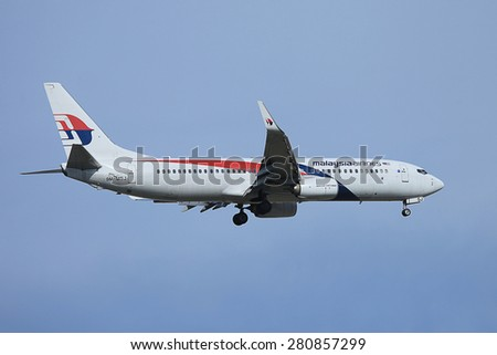 BANGKOK THAILAND - MAY 17 : Malaysia airlines flying in the sky by Airbus Boeing 737-800 two jet engines at Suvarnabhumi international airport in Bangkok Thailand on 17 May 2015  - stock photo