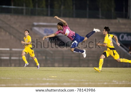 BANGKOK THAILAND- MAY 28 : O.Chukwuma (P) in action during Thai Premier League (TPL) Divition 1 between BB-CU Fc (P) vs Cat Today Janburi (Y) on May 28, 2011 at Army Stadium in Bangkok Thailand