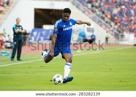 BANGKOK THAILAND MAY 30:Ola Aina of Chelsea run with the ball during the Singha Chelsea fc. Celebration match Thailand All-Stars and Chelsea FC at Rajamangala Stadium on May 30,2015 in Thailand. - stock photo