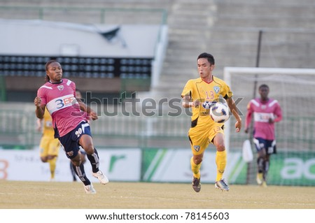 BANGKOK THAILAND- MAY 28 : P.Suksai (R) in action during Thai Premier League (TPL) Divition 1 between BB-CU Fc (P) vs Cat Today Janburi (Y) on May 28, 2011 at Army Stadium in Bangkok Thailand