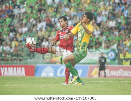 BANGKOK; THAILAND- MAY 19 : Pichet Sadeen (L) in action during Toyota Thai premier League 2013 between Army Utd vs Songkha Utd on May 19; 2013 at Army Stadium; Bangkok; Thailand