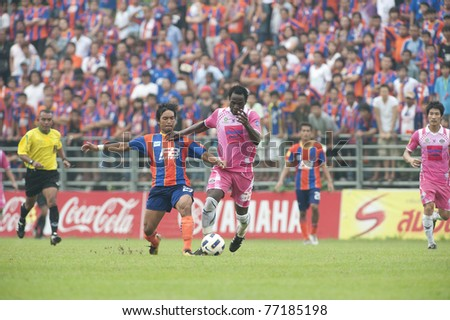 BANGKOK, THAILAND- MAY 14: S.Omotosho (pink) in action during Thai Premier League (TPL) between thai port fc (Orange) vs Srisaket fa (pink) on May 14, 2011 at PAT Stadium in Bangkok Thailand