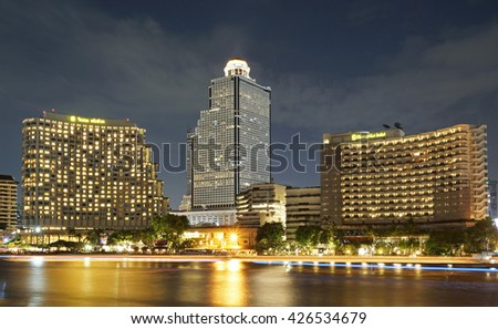 BANGKOK, THAILAND - May 25, 2016: Shangrila, hotel by the river, in the night with light trails from a boat taxi