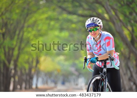 BANGKOK THAILAND - MAY 14:  Sportswoman ride bike at Nongbon Water Sports Center. It is great place for water sports, bicycle ride, basketball and outdoor activities on MAY 14, 2016