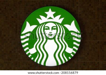 Bangkok, Thailand-May 1st 2014. Starbucks logo on a cafe wall in Bamgkok. Starbucks coffee shops are located all over Bangkok. - stock photo
