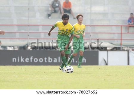 BANGKOK THAILAND- MAY 25 : T.Wongsupalak (yellow) in action during Thai Premier League (TPL) between thai port fc (Orange) vs TTM Pijit (yellow)   on Msy 25, 2011 at PAT Stadium in Bangkok Thailand
