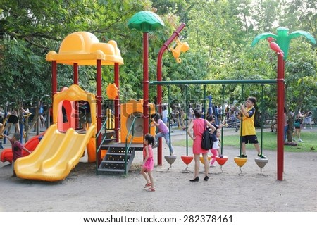 BANGKOK THAILAND - MAY 24 : Unidentified children play in playground on May 24, 2015 at Rama 9 park in Bangkok, Thailand