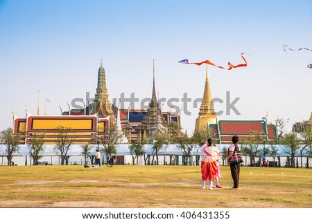 """Bangkok, Thailand- May 12, 2016 : Unidentified people in playing in """"Sanam Luang"""".It is the open field for flying kites. Exterior of Wat Phra Kaew, Temple of the Emerald Buddha. - stock photo"""