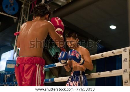 "BANGKOK THAILAND- MAY 18: Unidentified players in Muaythai ""MBK Fight Night"" on May18, 2011 at MBK Avenue Ring, Bangkok Thailand - stock photo"