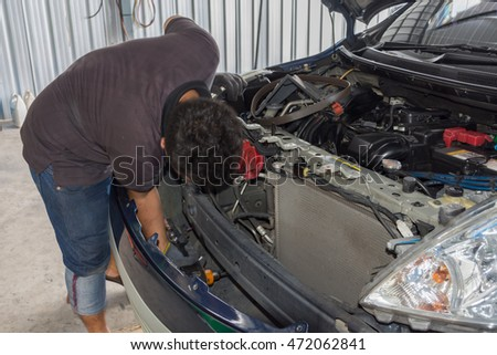 Bangkok, Thailand - May 15, 2016 : Unidentified serviceman checking a car for fix and repair at garage