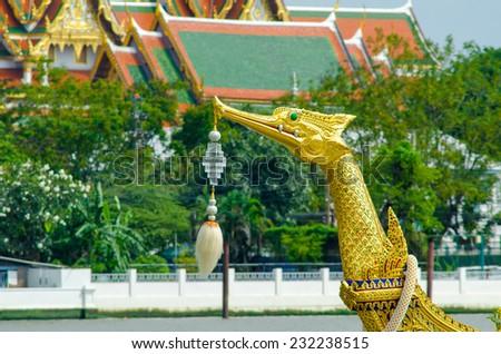 BANGKOK,THAILAND-NO VEMBER 9:Decorated barge parades past the Grand Palace at the Chao Phraya River during Fry the Kathina ceremony cloth of Royal Barge Procession on Nov. 9, 2012 in Bangkok,Thailand - stock photo