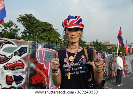 BANGKOK, THAILAND - NOV 11, 2013: A woman joins a city centre anti government rally. The Thai capital is experiencing ongoing political instability and daily street protests. - stock photo