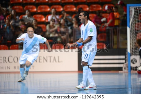 BANGKOK,THAILAND-NOV 09:Alan Aguilar#11of Guatemala celebrates whit team mate during the FIFA Futsal World Cup between Solomon Islands and Guatemala at Indoor Stadium Huamark on Nov9,2012 in,Thailand.