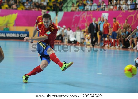 BANGKOK, THAILAND - NOV 14:Alemao of Spain (r) in action during the FIFA Futsal World Cup Quarterfinal Round between Spain and Russia at Nimibutr Stadium on Nov14,2012 in Bangkok, Thailand. - stock photo