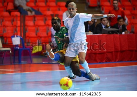 BANGKOK,THAILAND-NOV 09:Armando Escobar of Guatemala (white) in action during the FIFA Futsal World Cup between Solomon Islands and Guatemala at Indoor Stadium Huamark on Nov9,2012 in,Thailand.