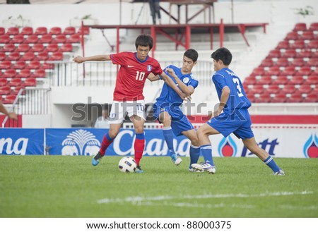 BANGKOK, THAILAND - NOV 2: B.Bongjae (R) in action during AFC U-19 Championship 2012 between Korea Republic (R) and Guam (B) at Debhatsadin Stadium on November 2, 2011 in Bangkok, Thailand