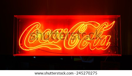 BANGKOK, THAILAND - NOV 11: Coca Cola red sign on November 11, 2014. Coca-Cola is a carbonated soft drink sold in stores, restaurants, and vending machines throughout the world - stock photo