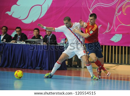 BANGKOK, THAILAND - NOV 14:Edder Lima of Russia (w) in action during the FIFA Futsal World Cup Quarterfinal Round between Spain and Russia at Nimibutr Stadium on Nov14,2012 in Bangkok, Thailand. - stock photo