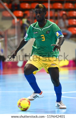 BANGKOK,THAILAND-NOV 09:Elliot Ragomo of Solomon Islands runs with the ball during the FIFA Futsal World Cup between Solomon Islands and Guatemala at Indoor Stadium Huamark on Nov9,2012 in,Thailand.