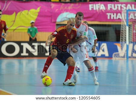 BANGKOK, THAILAND - NOV 14:Fernandao of Spain (r) in action during the FIFA Futsal World Cup Quarterfinal Round between Spain and Russia at Nimibutr Stadium on Nov14,2012 in Bangkok, Thailand.