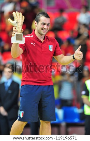 BANGKOK, THAILAND - NOV 18: Goalkeeper Stefano Mammarellla of Italy is the adidas Golden Glove after the FIFA Futsal World Cup Final at Indoor Stadium Huamark on November 18, 2012 in Bangkok,Thailand. - stock photo