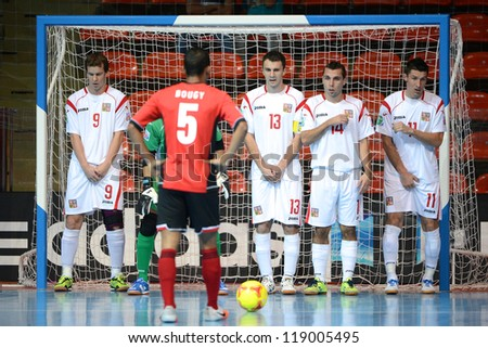 BANGKOK,THAILAND-NOV 06:Islam Gamila (no.13) of Czech Republic in action with team mate during the FIFA Futsal World Cup Egypt and Czech Republic at Indoor Stadium Huamark on Nov6, 2012 in,Thailand. - stock photo