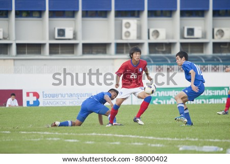 BANGKOK, THAILAND - NOV 2 : J.Jaemoon (R) in action during AFC U-19 Championship 2012 between Korea Republic (R) and Guam (B) at Debhatsadin Stadium on November 2, 2011 in Bangkok, Thailand