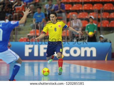 BANGKOK, THAILAND-NOV 18: Jorge Abril of Colombia (y) runs with the ball during the FIFA Futsal World Cup between Italy and Colombia at Indoor Stadium Huamark on Nov18,2012 in Bangkok,Thailand. - stock photo