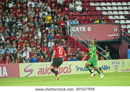 BANGKOK, THAILAND - NOV 22 : L.Dos Santos (R) in action during Thai Premier League (TPL) between Muang Thong Utd (R) and Army Utd (G) at Yamaha Stadium on November 22, 2011 in Bangkok, Thailand
