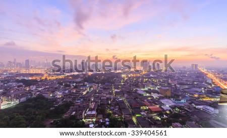 Bangkok,Thailand-Nov 14.LPN costly condominium at dusk with Chao Phraya river with cloud and sun raise on Nov 14,2015 - stock photo