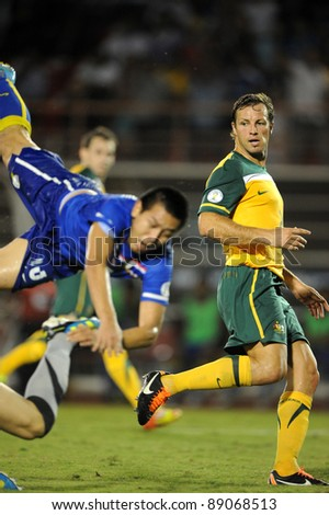 BANGKOK THAILAND - NOV 15: Lucas Neill  of Australia  in action during The FIFA WORLD CUP 2014 between Thailand(B) and Australia (Y) at Supachalasai Stadium on Nov 15, 2011 Bangkok, Thailand.