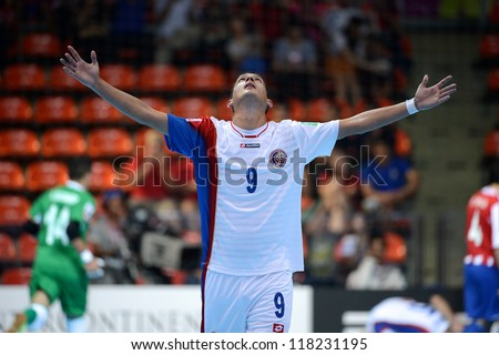 BANGKOK,THAILAND-NOV 4:Marco Carvajal of Costa Rica (white)celebrates during the FIFA Futsal World Cup between Paraguay and Costa Rica at Indoor Stadium Huamark on Nov4, 2012 inThailand.