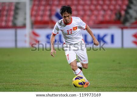 BANGKOK THAILAND-NOV 24:Nguyen Vu Phong of Vietnam (white) runs with the ball during the AFF Suzuki Cup between Vietnam and Myanmar at Rajamangala stadium on Nov24, 2012 in Bangkok,Thailand.