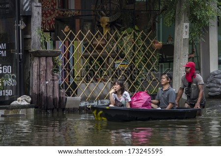 BANGKOK, THAILAND - NOV 5, 2011: People with their transportation during a big flooding in Thailand. At Phongphet junction, Ngamwongwan road. - stock photo