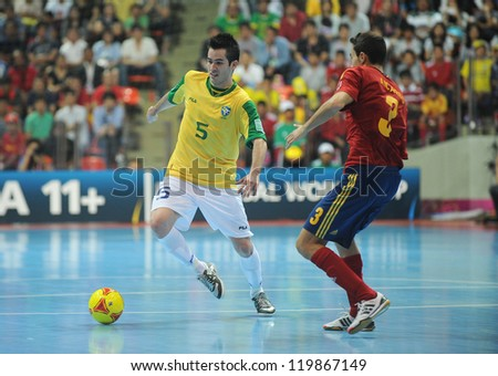 BANGKOK, THAILAND - NOV 18 : Rafael of Brazil during action in FIFA Futsal World Cup thailand 2012 Between Spain (R) VS Brazil (Y) on November 18, 2012 at Indoor Stadium Huamark in Bangkok Thailand. - stock photo