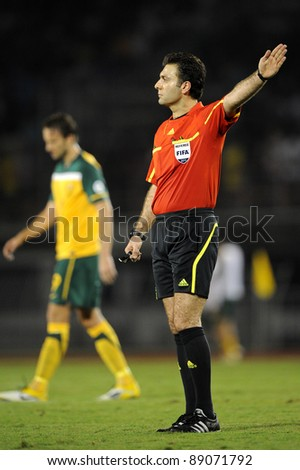 BANGKOK THAILAND - NOV 15: Referee Saeid Mozaffari of Iran in action during The FIFA WORLD CUP 2014 between Thailand(B) and Australia (Y) at Supachalasai Stadium on Nov 15, 2011 Bangkok, Thailand. - stock photo