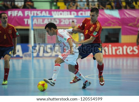 BANGKOK, THAILAND - NOV 14:Robinho of Russia (w) in action during the FIFA Futsal World Cup Quarterfinal Round between Spain and Russia at Nimibutr Stadium on Nov14,2012 in Bangkok, Thailand. - stock photo