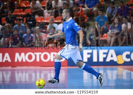BANGKOK,THAILAND-NOV18:Rodolfo Fortino (blue) of Italy control the ball during the FIFA Futsal World Cup  between Italy and Colombia at Indoor Stadium Huamark on Nov18,2012 in,Thailand. - stock photo