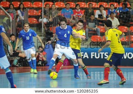 BANGKOK, THAILAND-NOV 18: Sergio Romano of Italy (b) in action during the FIFA Futsal World Cup between Italy and Colombia at Indoor Stadium Huamark on Nov18,2012 in Bangkok,Thailand. - stock photo