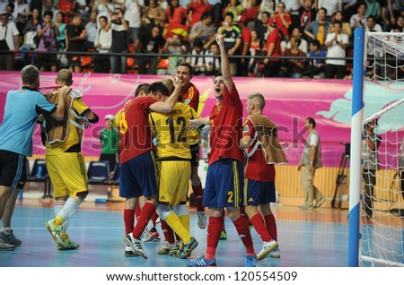 BANGKOK,THAILAND-NOV14:Spain celebrates after defeating Russia during the FIFA Futsal World Cup Quarterfinal Round between Spain and Russia at Nimibutr Stadium  on Nov14,2012 in Bangkok,Thailand. - stock photo
