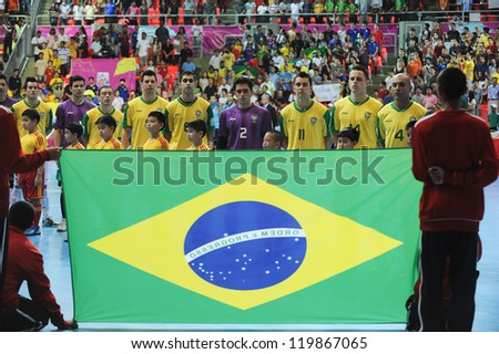 BANGKOK, THAILAND - NOV 18 :  the national anthem of Brazil in FIFA Futsal World Cup thailand 2012 Between Spain  VS Brazil  on November 18, 2012 at Indoor Stadium Huamark in Bangkok Thailand. - stock photo