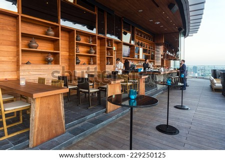 BANGKOK, THAILAND - NOV 29, 2013: The terrace of Octave rooftop Bar in Bangkok, Thailand. The Octave bar is located in the Thong Lor district near Sukhumvit road. - stock photo