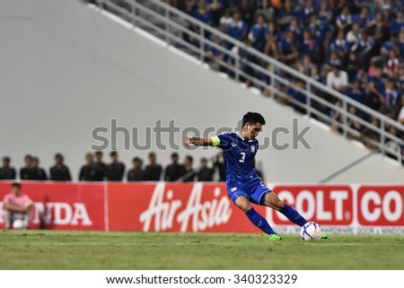 BANGKOK THAILAND NOV12 2015 :Theerathon Bunmathan of Thailand in action during the Fifa World Cup Group F qualifying Match between Thailand and Chinese Taipei at Rajamangala Stadium in Thailand.