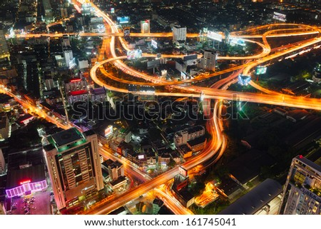 BANGKOK, THAILAND - NOV 5 : Top view of Baiyoke building which can see Expressways at twilight time on November 5, 2013, Baiyoke Building is highest building of Thailand, Thailand  - stock photo