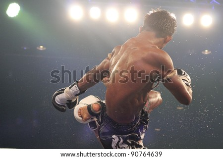 BANGKOK, THAILAND- NOV 27 : Unidentified boxers compete in Thai Fight:Muay Thai. World's Unrivalled Fight on November 27, 2011 at Convention Hall, Imperial World Samrong, Samutprakan, Thailand - stock photo