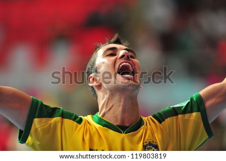 BANGKOK, THAILAND - NOV 14: Unidentified players in FIFA Futsal World Cup Quarter-Final match between Argentina (B) and Brazil (Y) at Indoor Stadium Huamark on November 14, 2012 in Bangkok, Thailand. - stock photo