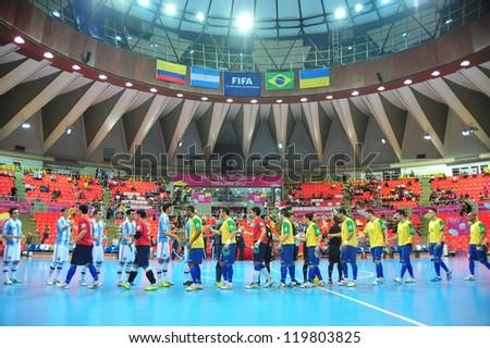 BANGKOK, THAILAND - NOV 14: Unidentified players in FIFA Futsal World Cup Quarter-Final match between Argentina (B) and Brazil (Y) at Indoor Stadium Huamark on November 14, 2012 in Bangkok, Thailand. - stock photo