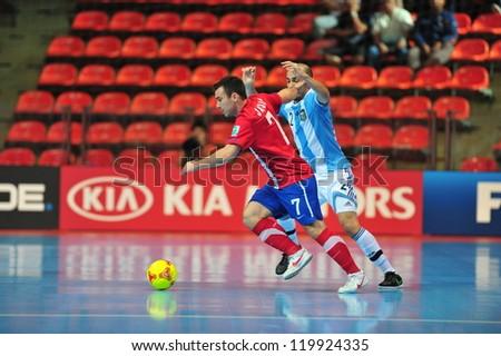 BANGKOK, THAILAND - NOV 12 : Unidentified players in FIFA Futsal World Cup Round of 16 match between Serbia (R) and Argentina (B) at Indoor Stadium Huamark on November 12, 2012 in Bangkok, Thailand - stock photo