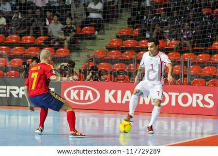 BANGKOK, THAILAND - NOV 2 : Unidentified players in FIFA Futsal World Cup thailand 2012 Between Spain (R) VS Iran (W) on November 2, 2012 at Indoor Stadium Huamark in Bangkok Thailand. - stock photo