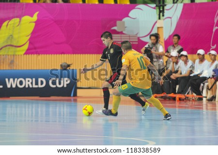 BANGKOK, THAILAND - NOV 5 : Unidentified players in FIFA Futsal World Cup thailand 2012 Between Mexico (B) VS Australia (Y) on November 5, 2012 at Nimibutr Stadium in Bangkok Thailand. - stock photo